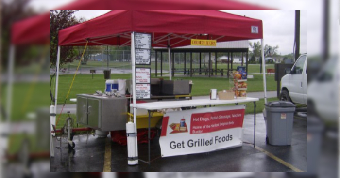 hot dog cart under canopy